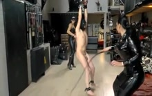 Girls in latex whipping their slave