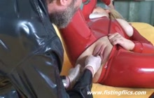 Latex Bitch Takes Bottle And Fist