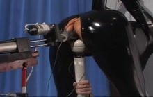 Slave in latex fucked by a machine