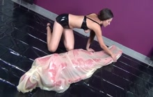 Girl in latex getting a choking punishment