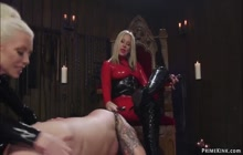 Rubber femdoms whipping inked sub