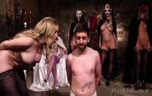 Dominas in hot costumes slapping a slave around
