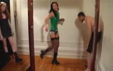 Crazy bitches in latex kicking a submissive dude in the nuts