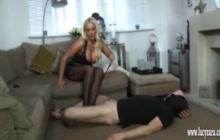 Mistress in latex kicks her slave in the nuts